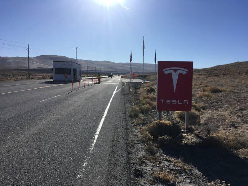 Gated entry to the Tesla Gigafactory.