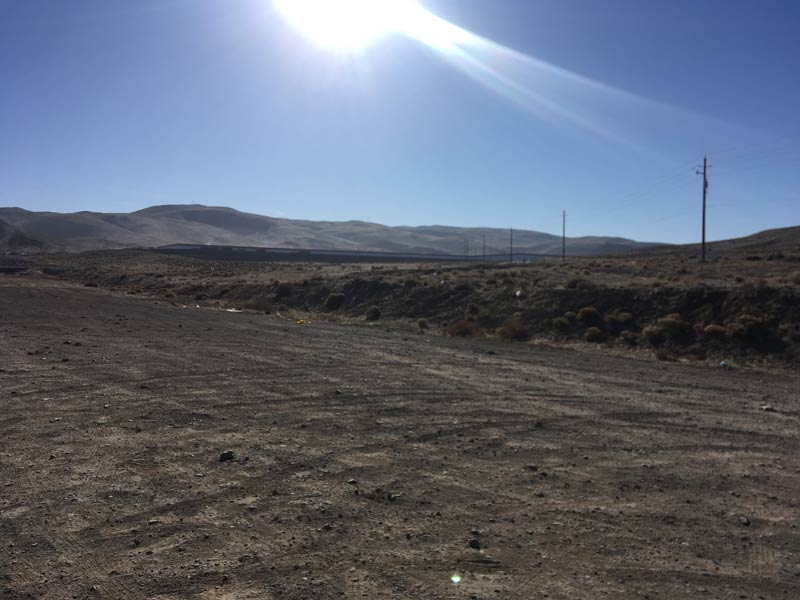 The Tesla Gigafactory only appears as a thin line on the landscape.