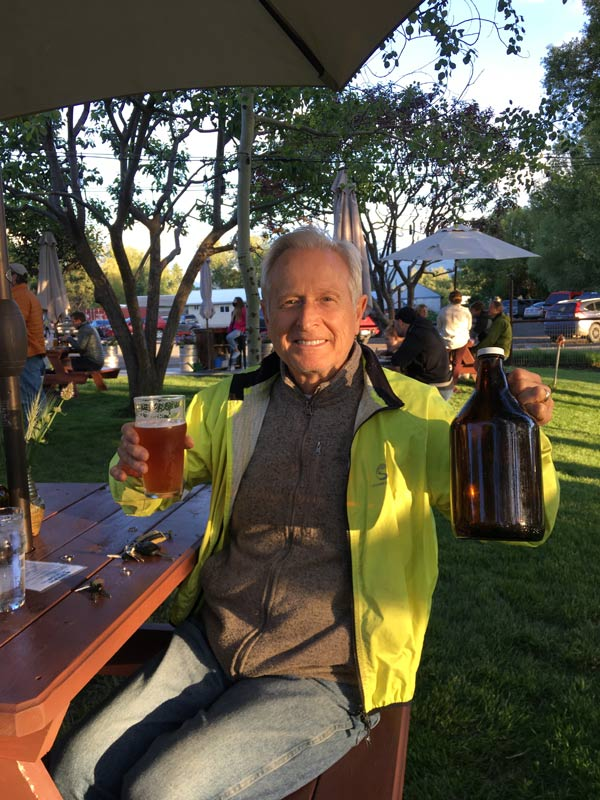 John at the Terminal Gravity Brewery in Enterprise, Oregon holding a pint and a growler of IPA - the finest in all the land!