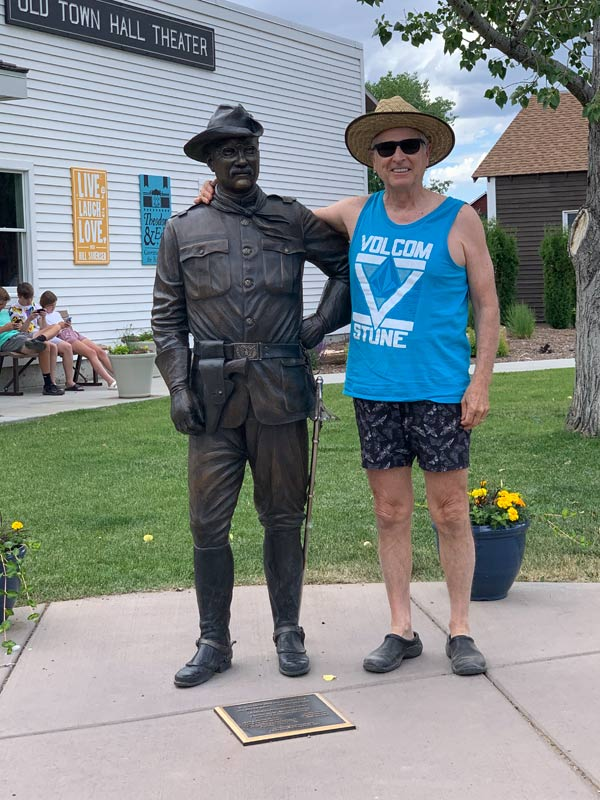 John posing with a statue of Teddy Roosevelt. I'm quite sure given the environmentalist he was he would quite appoove of Sunride.