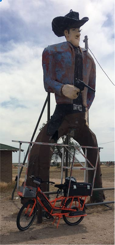 20' tall metal cowboy stands guard while I change my flat tire.