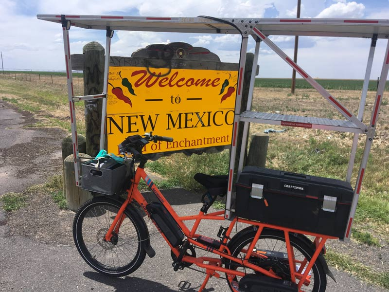 Sunride in front of the New Mexico welcome sign