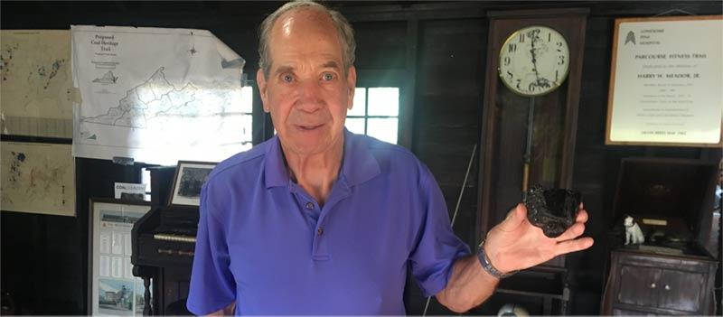 Freddie Elkins, holding a lump of bituminous coal