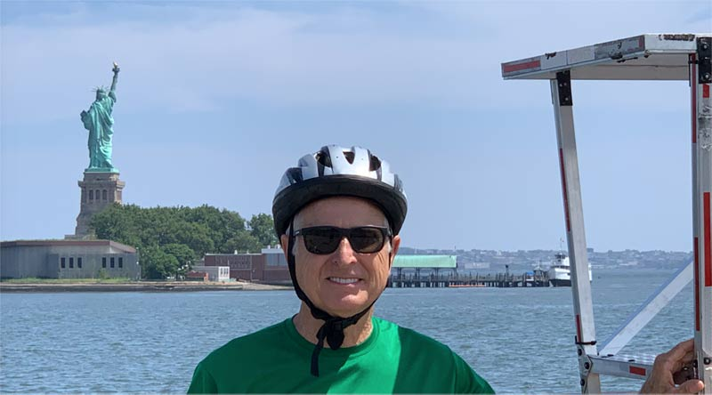 JP and Sunride with the Statue of Liberty in the background