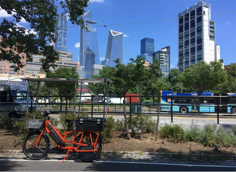 Sunride pauses on the bike trail to take in some of the new buildings in Mid-town Manhattan