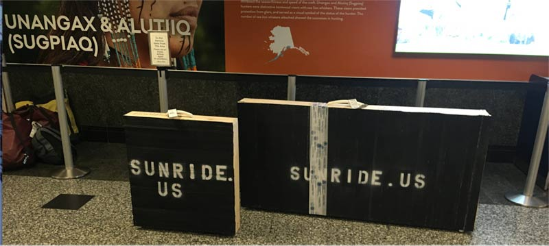 Two crates holding Sunride in baggage claim