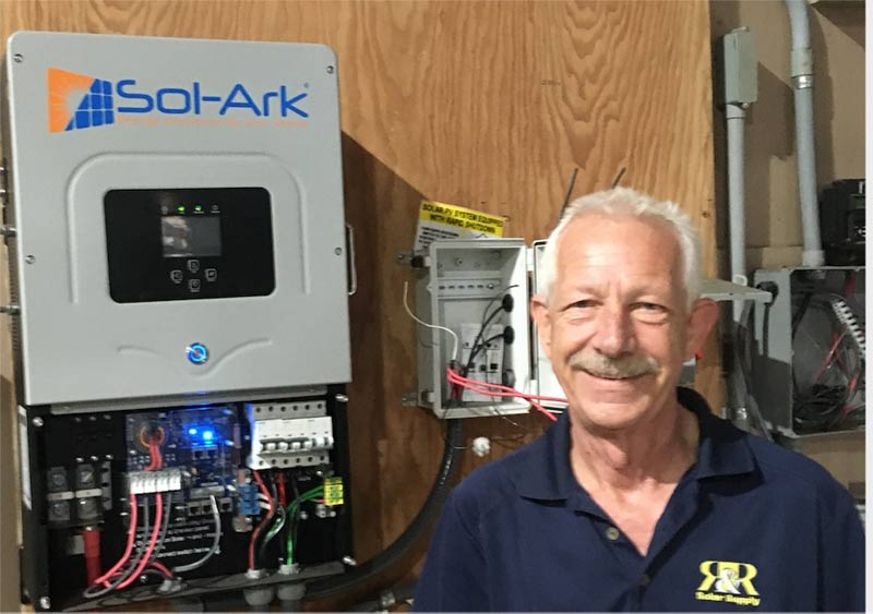 Rolf shows off his combination battery based and grid-tied solar electric system.
