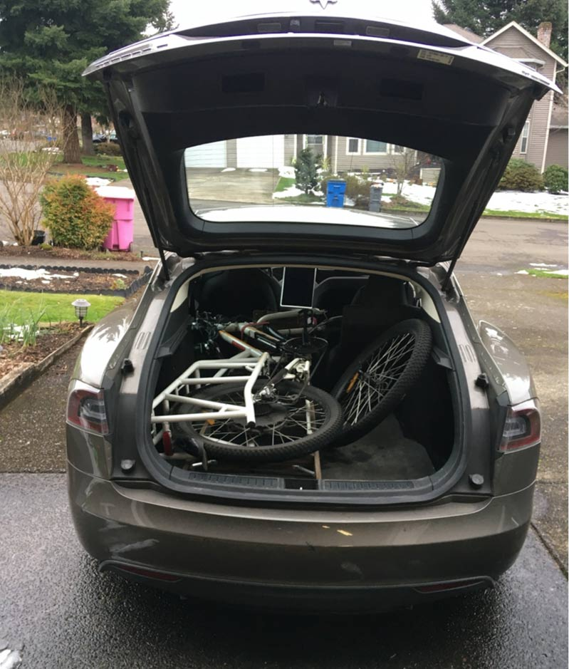 Open trunk of my Tesla with my electric bike, Sunride, which fit inside once I took the front wheel off.