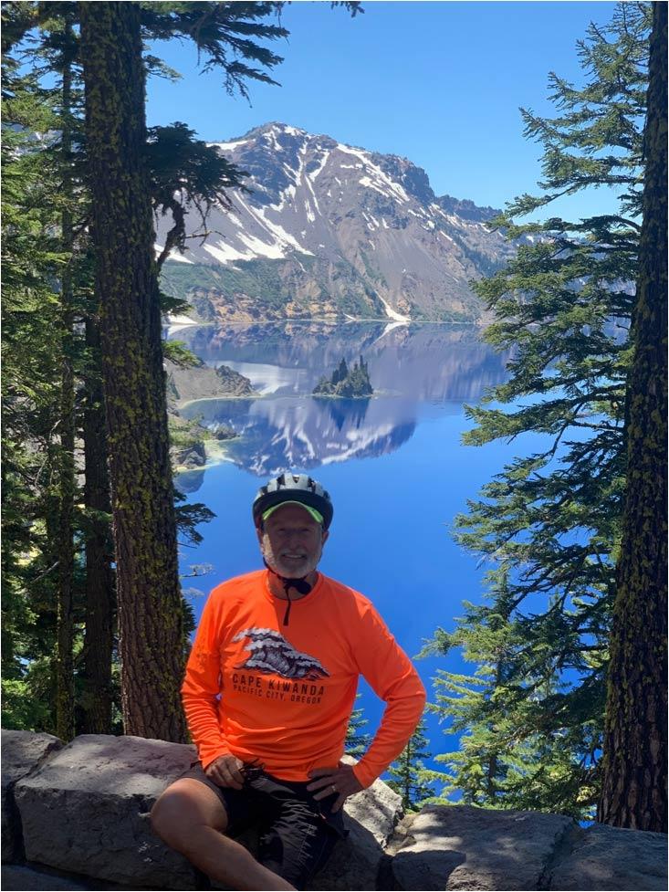 John posing in front of Crater Lake.